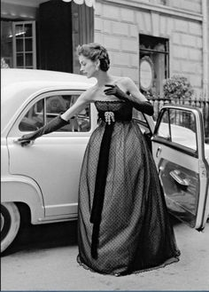 Model wearing an empire waist, point d'esprit evening dress by Christian Dior, 1951.