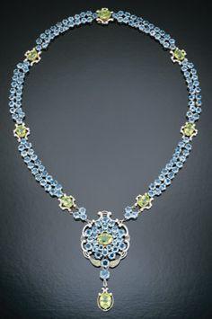 Aquamarine and peridot necklace, circa 1917.