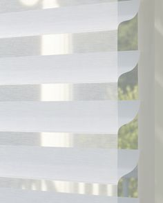 Silhouette® window shadings offer an ideal combination of translucent light diffusion, precise light control, and refined style. ♦ Hunter Douglas window treatments