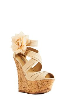Fun and Flirty this shoe is awesome for any occasion! Date Night, Wedding, walks on the boardwalk this ultra feminine wedge shows them who owns the moment!