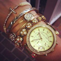 Micheal Kors watch  Ball rhinestone bracelet-from Francesca's  Gold rhinestone circle bangles- 3 to a pack at Target!  Rhinestone Cross bracelet- EBAY! super cheap too!