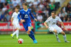 Everton's John Stones under pressure from Swansea City's Gylfi Sigurdsson.