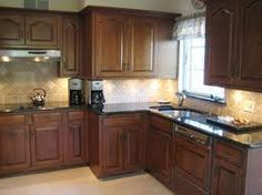 Refinished oak cabinets--Darkening them a little could make a world of difference.