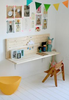This cute desk looks like a miniature bench. It's a simple built-in shelf-like desk and it's a great space-saver in a kids' room. Plus, the workbench design gives it an interesting look.