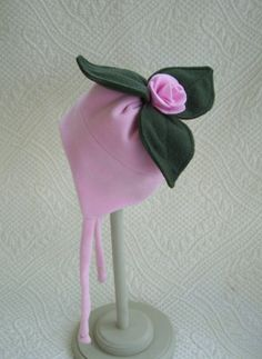 Childs light pink fleece tie hat with your choice of silly top