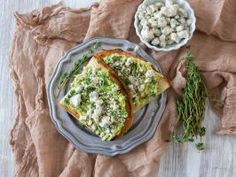 Blue Cheese and Herb Avocado Toast : <p><b>What You'll Need:</b>1 ripe avocado   1/2 lime   2 slices crusty toasted bread   1/4 cup crumbled blue cheese   fresh herbs, for sprinkling (chives, thyme or basil would all be great)</p>  <p></p>  <p><b>What to Do:</b> Cut avocado in half and remove the seed. Squeeze lime juice in each half of the avocado. Mash in its shell and spread over both slices of toast. Top with crumbled blue cheese and fresh herbs. </p>