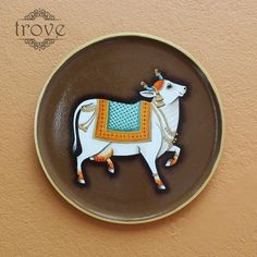 Wall decor plates handpainted with Pichwai Theme Cow Painting, Garden Painting, Fabric Painting, Onam Greetings, Indian Ceramics, Cow Illustration, Pichwai Paintings, Line Art Design, Tanjore Painting