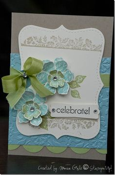 "SU Crumb cake card base, Baja blue layer embossed with the Vintage Wallpaper ef, half 1"" circles in Pear Pizzaz for scallop edge & Top Note die in Very Vanilla stamped w/ Vintage Vogue stamp.  flowers in Baja Breeze rolled in Pear Pizzaz ink to create the two tone effect, the border stamped in crumb Cake ink & leaves in Pear pizzaz.  Pear Pizzaz seam binding. Flowers stamped twice & raised w/ dimentionals,. Sentiment from Something to Celebrate & punched with Modern Label punch. Add…"