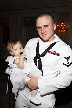 Heather Moxcey will wear red to support Gilbert Padilla in the US Navy.  Gilbert is shown with his daughter, Alexa.
