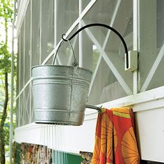 Lakeside cabin makeover: lake house cottage shower bucket < How one couple turned a run-down Georgia lake house, cottage, cabin into the makeover retreat of their dreams. Lakeside Cottage, Lake Cottage, Lakeside View, Outside Showers, Outdoor Showers, Outdoor Baths, Outdoor Rooms, Cottage Showers, Farm Style Table