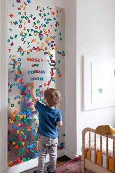 A simple steel sheet mounted on the wall of the nursery and the addition of magnetic letters provides tons of opportunity for learning words
