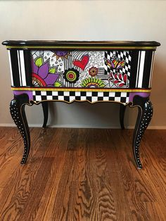 This end table is the only one of its kind!My daughter drew most of the flowery designs on it and I hand painted the table. This table has a glossy polyeurethane finish and will brighten and bring whimsy to your life. Colorful Furniture, Decor, Rowe Furniture, Painted End Tables, Whimsical Furniture, Painted Chairs, Painted Furniture, Whimsical Painted Furniture, Funky Painted Furniture