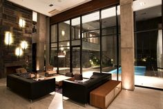 Incredible mix of light and materials: concrete, wood, leather and glass.