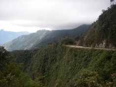 """biking """"The World's Most Dangerous Road"""" in #Bolivia #landscapes #dangerous #extreme #mountain http://sorryimnotsorryblog.com/that-one-time-i-was-rescued-off-a-mountain-face-by-bolivian-swat/"""