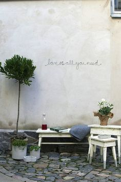 Love is all you need. Would probably do another quote but I like the idea of painting it on a garden wall Outside Living, Outdoor Living, Herb Garden, Home And Garden, Garden Nook, Garden Walls, Sun Garden, Garden Club, Outdoor Spaces
