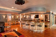 Basement with a full bar, pool table, AND tv area.  Perfect for hosting.