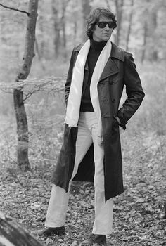 """Fashions fade. Style is eternal."" Yves possess outdoors in a leather trench and sunglasses for a CBS special, 1986."