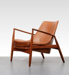 "Ib Kofod Larsen Low Back ""Seal"" Chair. The original (shown here) was made by OPE Möbler, 1956."