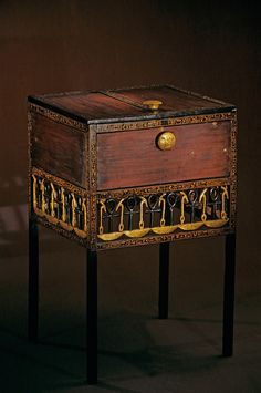 Decorative chest with long legs, Tutankhamun and the Golden Age of the Pharaohs, Page 244