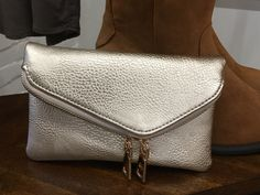 The perfect little clutch in a Fall metallic shade. 👝 $42 #ShopALB #ApricotLaneTS
