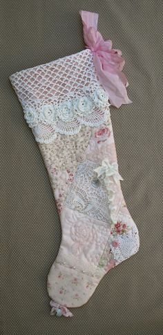 A peachy pink patchwork Christmas stocking. Quilted patchwork loaded with lots of vintage embellishments! Silk ribbon, lace trims, beads, lace,
