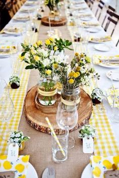 I like this pic. I think yellow would go with the silver chevron print hessian table runners too if we go with that!