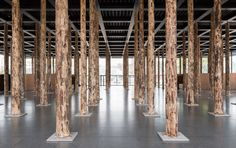 David Chipperfield installs tree trunk columns in Mies van der Rohe's Neue Nationalgalerie.