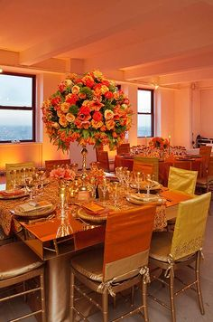 Persimmon and gold chair covers matched the metallic chic decor at this wedding reception.