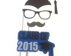 4 Piece Graduation Photo Booth Prop Collection. Choose your sign color and school year from the dropdown box.  *All props will come attached to wooden dowels. *Please leave date of event at checkout. *All props made with quality heavy cardstock.  Measurements  1-Graduation Caps approx. 10 1- Pairs of Glasses approx. 6 1/2 1- Lips (glitter) approx. 2 1/2 1- Sign approx. 7  © All Designs featured in this listing are property of Crafting by Denise and should not be copied or duplicated...