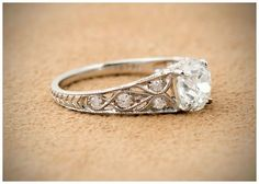 Antique engagement ring with a 1.49 carat Old Mine cut center diamond in platinum.