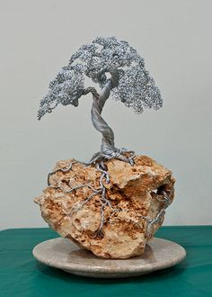 Wire Sculpture- Seriously would look great in my little indoor zen garden!