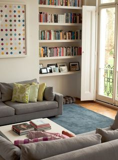 Cozy living room #casual #home #bookshelf #gray #couch #modern