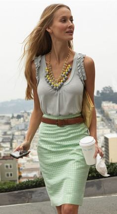 Even the most classic pencil skirt looks fresh when paired with a trendy blouse, a chunky necklace, and a short stack of bangles. Accessories transform the most basic uniform into a statement-making look. For day, wear this outfit with a cropped blazer; but shed the jacket and layer on a few extra bangles for a happy hour-worthy ensemble.