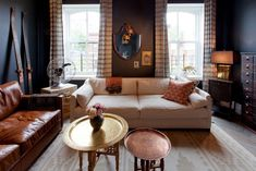 Genevieve's Renovation -Genevieve Gorder's home Love her black living room with both cream & leather sofas. She also blew up a historical photograph of the ship pulling into harbor that her grandmother immigrated to the states on!