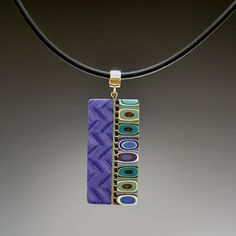 Polymer necklace.  Love the purple.