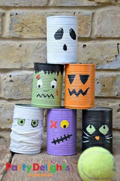 Halloween tin can bowling. Tin cans are not just for stacking up in your cabinet, tossing in the trash or sending to the recycle bin. Combine those with a rope, paints, craft papers and a generous helping of crazy imagination, and you will have a cool creation on your hands.