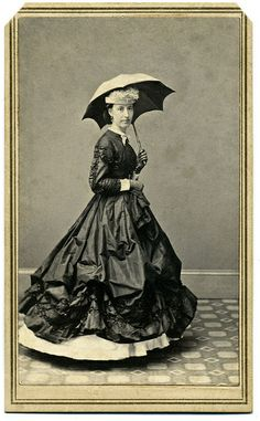 Another interesting image, I do have questions about the skirt, perhaps there were some sort of lifters in use, I am not sure.      Woman holding parasol    Carte de visite by F. Forshew of Hudson, N.Y. A woman wearing gloves and a silk dress stands with a parasol in her left gloved hand.