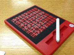 This FREE PLAY MAGNATAB is great for creating Braille letters.  It helps the student to learn to gently sweep the finger over the Braille in order to read it.  If the student puts too much pressure on it, the Braille dot falls in. Use Graphic tape to make Braille Cells. (Merry-Noel Chamberlain, TVI.) Great for playing word games, too!