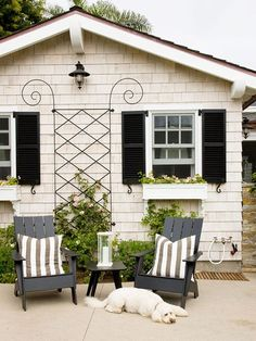Thought black on your home's exterior would be a bad look? Installing window shutters in a color that matches the rest of your home's exterior is an easy way to bump up your curb appeal👌 Double tap if you think the black works here! Home And Garden, Cottage, Outdoor Spaces, Windows Exterior, House Exterior, Window Shutters, House Painting, Curb Appeal, House Colors
