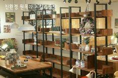 Berkley bookshelf made of merbau wood and steel frame