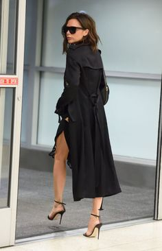 ♥️ Pinterest: DEBORAHPRAHA ♥️ Victoria Beckham looking extra chic wearing a black long trench coat and heels #street #style #victoria #beckham