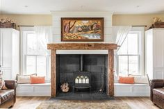 A Modern Rustic Farmhouse in Indiana (love the wood around the fireplace)