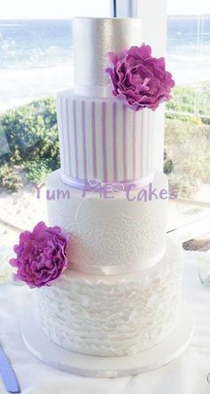 White and purple wedding cake with ruffles, stripes and stencilling - Yum Me Cakes