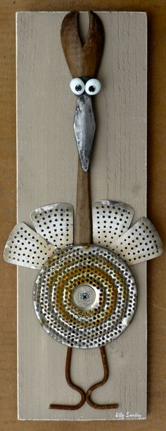 Wonderful bird made from old kitchen utensils, I love it!