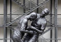 """A 16 foot-high bronze statue portraying French soccer player Zinedine Zidane's head-butting incident against Italian Marco Materazzi in the 2006 World Cup final has been erected in front of the Centre Pompidou in Paris. Created by Algerian artist Adel Abdessemed, the larger version of Abdessemd's earlier 'Coup de Tête' depicts the incident that marked the end of one of France's greatest athelete's career. This sculpture has been installed to accompany  Abdessemed's solo show at the…"