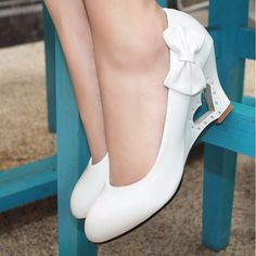 This glossy pair makes a stylish chic statement. Features round toe, slip on closure, covered with overall glossy design, lovely side bowtie and heart shape on the heel. Beauttifully crafted from PU,