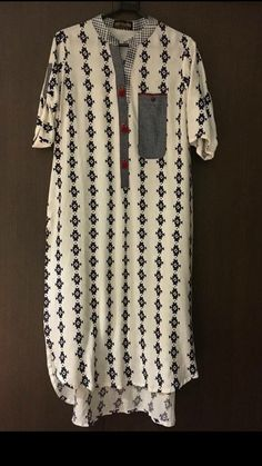 Cotton printed Kurti with patch and patti detailing.