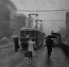 "Alex Howitt  - ""Rainy Day"", Undated. This is so cool. People going about their daily lives frozen in time by this photograph... incredible."
