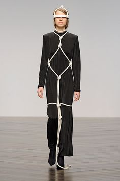 Central Saint Martins graduate Eilish Macintosh showed outfits tied up with knotted lengths of rope at the institution's show during London Fashion Week.