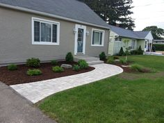 updated foundation planting and walkway with 'Brussels' pavers